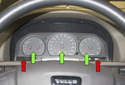 The instrument cluster on Volvo V70 models can be serviced as a whole unit or individual gauges (green arrows) and bulbs (red arrows).