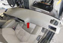 Slide the dashboard panel (red arrow) off the dashboard toward the rear of the vehicle.