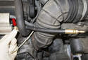 Pressure testing: Install the correct adapter for your gauge to the fuel rail (red arrow).