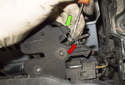 Remove the hood latch from the vehicle body.