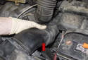 Pull the fresh air duct (red arrow) out of the radiator support and remove it from the intake air housing.