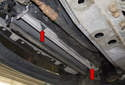 Install the new radiator into the engine compartment and install the fasteners.