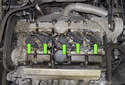 Ignition and knock control: The ignition system uses one ignition coil per cylinder (green arrows), with each coil mounted above a spark plug.