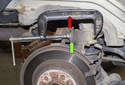 Then press the piston back into the caliper using a brake caliper piston tool or a C-clamp (red arrow).