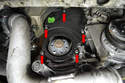 Remove the five T30 Torx screws on the lower timing belt cover (red arrows).