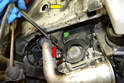 Use a universal joint and an 18mm socket and remove the lower mount to engine bolt (red arrow).