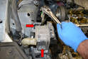 Remove the two 16mm bolts holding the mount to the chassis (red arrows).
