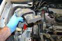 You can remove the chassis part of the engine mount (red arrow) from the vehicle.