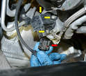 Separate the wiring connection (red arrow) and use a 5mm Allen to remove the three Allen bolts (yellow arrows, two bolts shown).