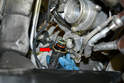 Pull the valve out from the turbo housing (red arrow).