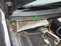Once the panel is removed, you will be able to access the cabin filter housing below (green arrow).