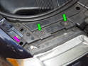 Left and Right Sides of car: Loosen and remove the two 10mm bolts (green arrows) securing the top of the headlight assembly to the car.