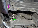 Left and Right Sides of car: Shown here is the location of the inner mounting bolt on the chassis (green arrow).