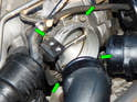 Now loosen and remove the four 5mm hex bolts (green arrows) holding the throttle body to the intake manifold.
