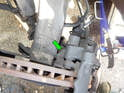 Now loosen but do not remove the 18 mm upper caliper mounting bolt (green arrow).