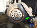 Now rotate the caliper upwards (green arrow) enough to allow you enough room to remove the lug bolt and brake disc from the wheel hub.