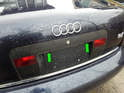 Shown here is the location of the license plate lights on your Audi A6 (green arrows).