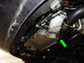 The oil drain bolt (green arrow) is located on the bottom edge of the oil pan on the side (green arrow).