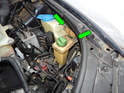 Now loosen and remove the two 10 mm bolts (green arrows) holding the reservoir to the body.