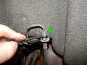 Rear: Use the 11 mm flare nut wrench to loosen the nut (green arrow).
