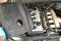 Engine- With all three screws loosened you can simply remove the cover off the top of the engine.