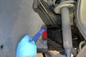 Front- There is one plastic push clip beside the steering rack and strut.