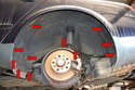 Rear- The rear liner is a single piece and is held in place by eleven T25 Torx screws (red arrows).