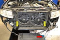 In this picture you can see the two lower rubber grommets that the radiator sits in(yellow arrows).