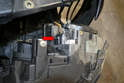 Slide the headlight assembly forward out from the front of the vehicle and separate the wiring connection from the back (red arrow).