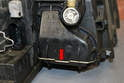 To change the high beam bulb release the wire clip (red arrow) and pull the cover off the back of the unit.