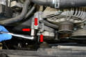 Use a 13mm socket and remove the three bolts holding the tensioner to the motor (red arrows).