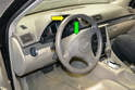 Using the steering column adjustment located on the underside of the steering column, pull the steering wheel away from the dash (yellow arrow) and lower (green arrow) it as far is it will go.