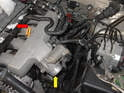 Remove the fuel injectors (red arrow) along with the throttle body hose (yellow arrow).