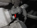 Remove the air intake sensor by sliding the metal retaining clip up and then pulling the connector off (red arrow).