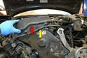 There are two lines connected to the top of the upper valve cover, a coolant line from the turbo (red arrow) and a vacuum line (yellow arrow).