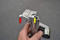 Install the new tensioner on the block BEFORE removing the tensioner locking tab (red arrow).