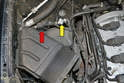 The area to the rear of the intake air box contains the EVAP valve (red arrow) and lines (yellow arrow).