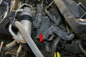 In front of and below the intake air box is the secondary air pump (red arrow).