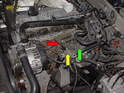With the intake manifold removed you can see the crankcase breather hose (red arrow) and the turbocharger recirculating valve (yellow arrow) and the secondary air injector solenoid (green arrow).