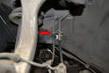 Front Sensor- Unclip the cable from where it mounts in the bracket by the brake line (red arrow).