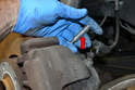 If you are reusing your guide bolts, check them for wear and tear (red arrow).