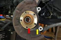 With the brake system off, you will be left with the wheel hub (red arrow) attached to the bearing in the bearing housing (yellow arrow).
