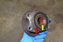 With the bearing and hub out of the housing, you can press the old hub out and either re-use it, if it is in good shape, or press a new bearing and hub together and install them back into the housing.