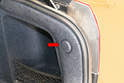 There is a single access cover on each side directly beside the taillight.