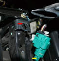 Install the wiring connection, push the brake pedal in and insert the plunger end into the mount (red arrow) and turn 45 degrees clockwise.