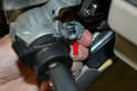 With the retaining clip lose you can wiggle the interlock cable out from the ignition assembly (red arrow).