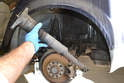 Compress the shock down by pushing on the top of it and remove it from the wheel well.