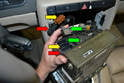 Remove the three wiring connections on the left side of the rear of the unit (red, yellow and green arrows).
