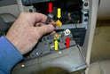 Remove the antenna and amp connections (red and yellow arrows).
