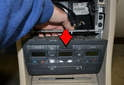 With the radio removed, reach into the opening above the climate control unit with your hand and gently push the unit forward (red arrow).